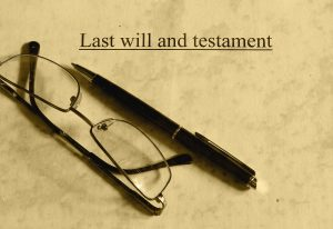 Last will, pen, and glasses