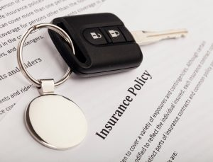 Car keys and insurance form