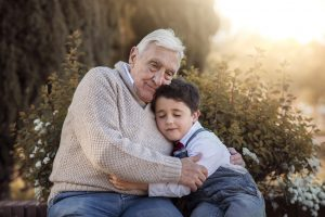 grandfather hugging grandson