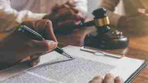 Judge writing on document